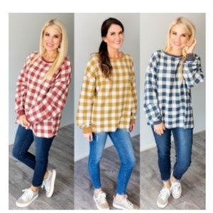Women's red and white checkered plaid sweater